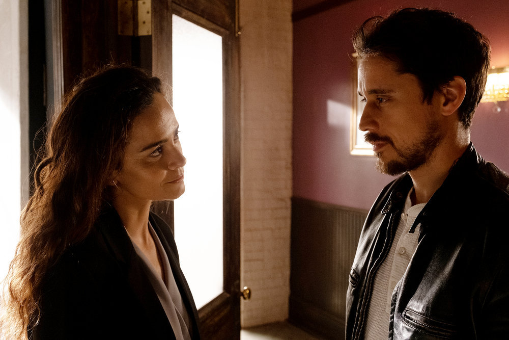 "QUEEN OF THE SOUTH -- ""Fantasmas"" Episode 501 -- Pictured: (l-r) Alice Braga as Teresa Mendoza, Peter Gadiot as James Valdez -- (Photo by: Patti Perret/USA Network)"