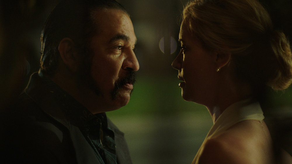 """QUEEN OF THE SOUTH -- """"No Te Pierdas La Cabeza"""" Episode 503 -- Pictured in this screengrab: (l-r) Hemky Madera as Pote, Molly Burnett as Kelly Anne Van Awken -- (Photo by: USA Network)"""