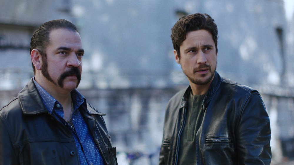 """QUEEN OF THE SOUTH -- """"Silver or Lead"""" Episode 506 -- Pictured in this screengrab: (l-r) Hemky Madera as Pote, Peter Gadiot as James Valdez -- (Photo by: USA Network)"""