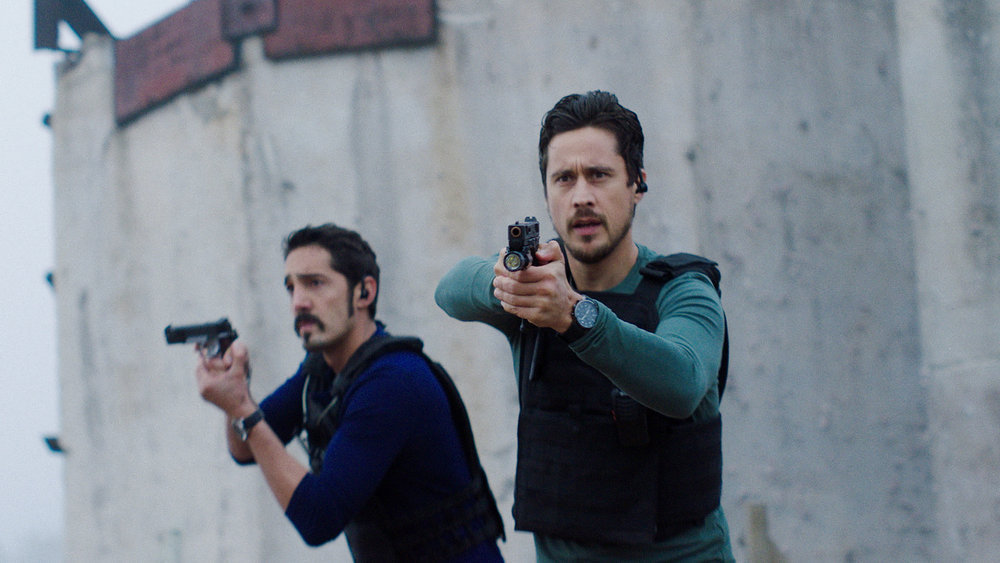"""QUEEN OF THE SOUTH -- """"Everything I Touch"""" Episode 508 -- Pictured in this screengrab: (l-r) Alejandro Barrios as Chicho, Peter Gadiot as James Valdez -- (Photo by: USA Network)"""