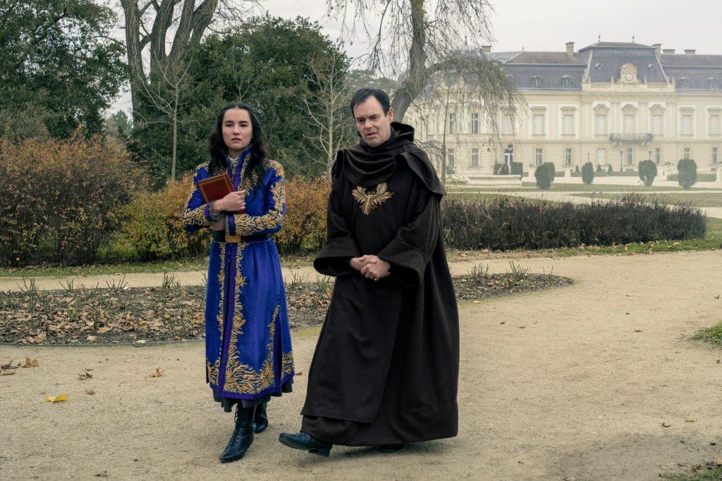 SHADOW AND BONE (L to R) JESSIE MEI LI as ALINA STARKOV and KEVIN ELDON as THE APPARAT in SHADOW AND BONE Cr. ATTILA SZVACSEK/NETFLIX © 2021
